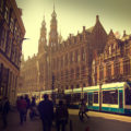 How to get to Amsterdam Airport Schiphol transport links train bus metro tram taxi bike